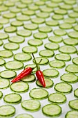 Red Hot Peppers on Cucumber Slices