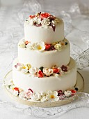 Three-tier wedding cake with fondant flowers