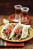 Shredded beef tacos and tequila shots