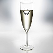 Diamond Ring Floating in Glass of Champagne