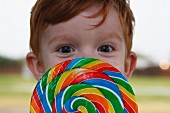 Boy Behind Rainbow Lollipop