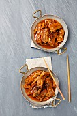Pork ribs braised in soy sauce with sugar, star anise, garlic and ginger