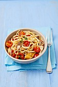 Spaghetti with cherry tomatoes and smoked mackerel