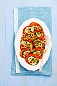 Tomato salad with olives and grilled courgette