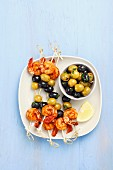 Prawn and olive skewers and marinated olives