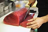 Chef Cutting Raw Tuna Steak