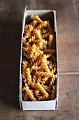Wholemeal fusilli in a cardboard box