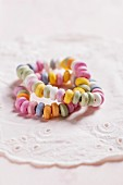 Colourful candy bracelets on a doily