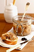 Rillettes of pork in a jar and on bread, with a pot of mustard