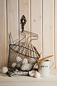 White chicken's eggs in a wire basket