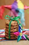 A stack of cookies tied with a ribbon and decorated with a star