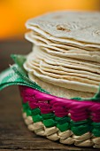 A stack of tortillas in a basket
