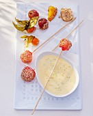 Vanilla cream with kefir limes, fruit kebabs and sesame seeds