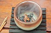 Smoking incense in incense bowl