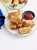 Puff pastry rolls filled with minced meat and served with a tomato sauce