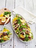 Staudensellerie-Orangen-Salat mit würzigem Fisch