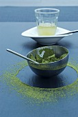 Green tea powder in a bowl and in a ring around it