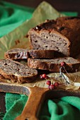 Rustic chocolate banana bread on a cutting board