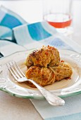Vegetarian stuffed cabbage rolls with quinoa, onions & carrots (gluten and dairy free)