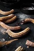 Spanish churros with sugar and dark cinnamon.