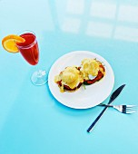 Eggs Benedict with Salmon and Red Mimosa Cocktail, High Angle View