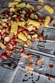 Low Country Boil with Shrimp, Corn, Sausage and Potatoes on Newspaper, High Angle View