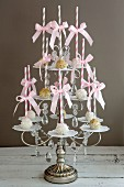 Assortment of Cake Popsicles with Striped Straws on Ornate Tiered Display