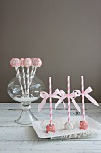 Festive Cake Popsicles with Striped Straws and Pink Ribbons
