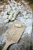 Uncooked gnocchi on a floured work surface
