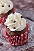 Chocolate cupcakes decorated with chocolate pearls