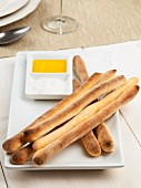 Home-made grissini (Italian breadsticks) with olive oil and sea salt