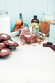 An arrangement of baking ingredients and chocolate cream cheese biscuits