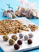 Pistachio and chocolate caramel and various orange truffles