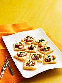Tomato and goats cheese puff pastry tartlets