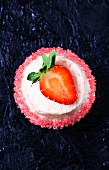 Daiquiri cupcake decorated with a strawberry and a sugared edge