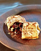 A pancake filled with dried fruit and nuts
