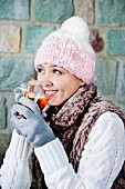 A woman drinking apple and cinnamon winter tea