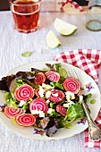 A mixed leaf salad with beetroot and feta cheese