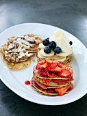 Stacks of mini pancakes with fruit