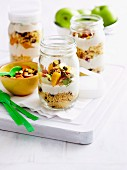 Orange juice couscous with yogurt and fruit layered in jars