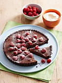 A chocolate tart with rosewater and raspberries