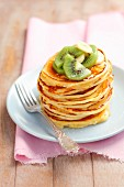 Buttermilk pancakes with kiwi, banana and honey
