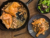 Chicken quarters with mushroom sauce and a mixed leaf salad