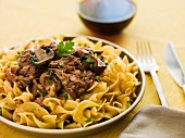 Egg noodles with mushrooms and an ox tail sauce