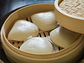 Bao buns in a bamboo steamer (China)