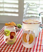 White wine sangria with strawberries, kiwis and peaches