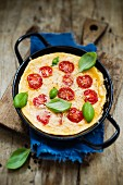 A tomato omelette with fresh basil