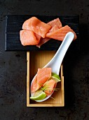 Salmon sashimi with limes (Japan)