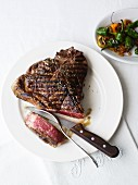 Grilled T-bone steak, sliced