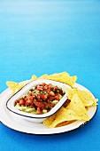 Tacos with an avocado dip and tomato salsa